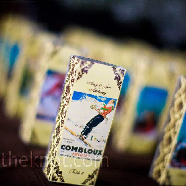 For escort cards as unique as their theme, the couple used fleur-de-lis wine stoppers in boxes decorated with vintage ski postcards.