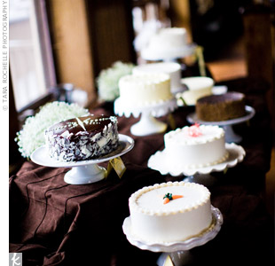 To celebrate their weakness for sweets, Lindsay and Drew served eight different buttercream frosted cakes in a variety of flavors. The couple cut into a coconut cake topped with a feathered bird they had found in a thrift store.