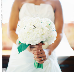Sprays of black beads added an unexpected element to Melyssa's all-white bouquet of hydrangeas, ranunculus, stephanotis and dendrobium orchids.