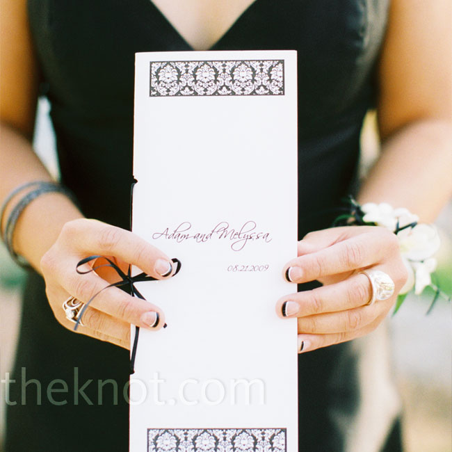 The bride and groom made the programs themselves with glittery white paper and the same damask detailing found on their wedding invitations.