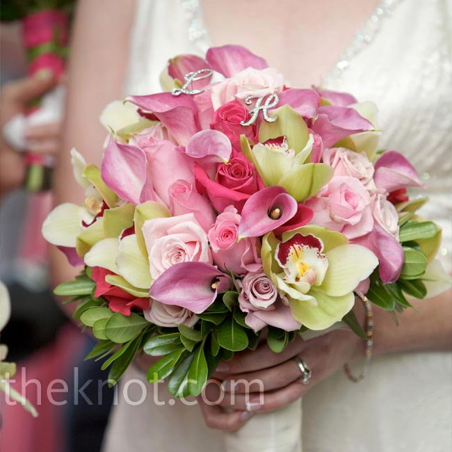 "Lizzy carried a bouquet of pink roses, calla lilies, and green cymbidium orchids accented with crystal letters -- an ""L"" and an ""H"" -- for her and Howard's initials."