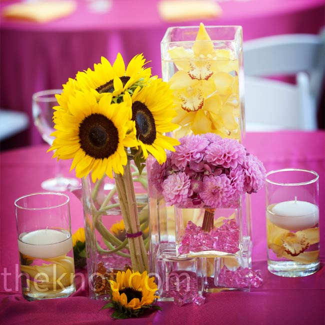 The first time Jonathan ever sent Kaili flowers, he unknowingly sent a bundle of her favorites -- sunflowers. The bright-yellow flower naturally became part of the wedding's theme and was paired with fuchsia for another bright pop of color.