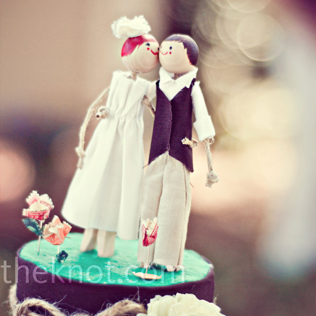 Mindy used clothespins to make the sweet cake topper, which was a miniature version of the bride and groom. Even their outfits matched!