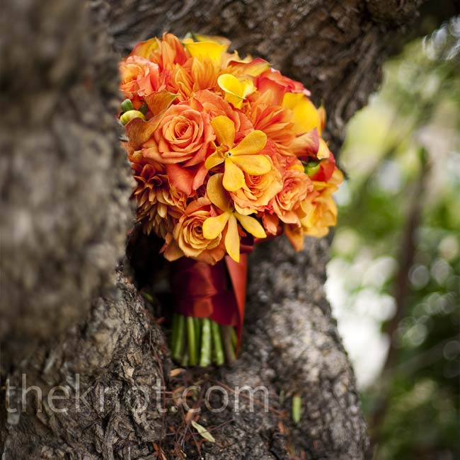 Leila has always loved the look of big, fluffy dahlias, so she knew she wanted them in her bouquet. And their orange color was perfect! The florist added orange mini calla lilies and a few orange orchids to give the bouquet more depth.