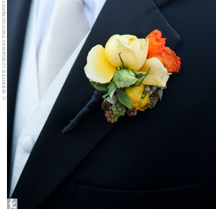 For a pop of color against his tux, Ryan's boutonniere included yellow garden roses and a single orange poppy. A few berries added to the wedding's rustic vibe.