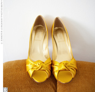 Rich, golden yellow satin pumps became the inspiration behind the bits of yellow that were worked into the color palette, such as the flowers and invitation envelopes.