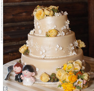 Margaret didn't have any ideas in mind when she and Ryan went for their cake tasting, so she simply picked one out of the baker's book. It was frosted with marzipan, and the florist added fresh roses and berries to the tiers to add a rustic look.