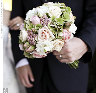 Tami carried a soft bouquet of pink roses, hydrangeas, sedum, and white lisianthus accented with tiny crystals.