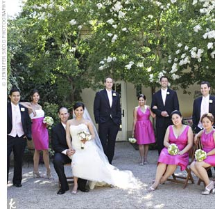 Tami's bridesmaids wore different styles of hot pink dupioni fabric dresses. The maid of honor stood out in a two-toned dress with an ivory top and hot pink skirt.