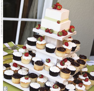 Cupcakes are Brian's favorite, so the couple served those instead of a cake. The treats of different flavors and frostings were served on a tiered stand topped with a small cake for the traditional cutting.