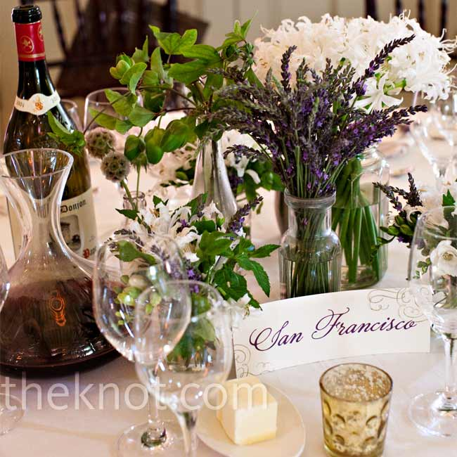 Each table had a different assortment of flowers. Some had a collection of vintage glass jars filled with bunches and herbs like mint, lavender, freesia, and white nerine lilies. Other centerpieces were more lush arrangements in wooden crates.