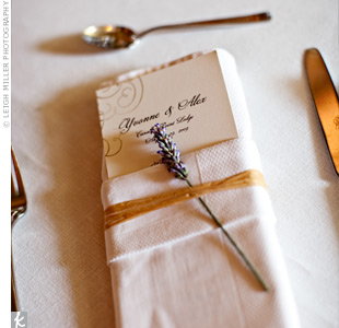 The menu cards were tucked inside folded napkins, which were then wrapped with twine and accented with a dried lavender sprig.