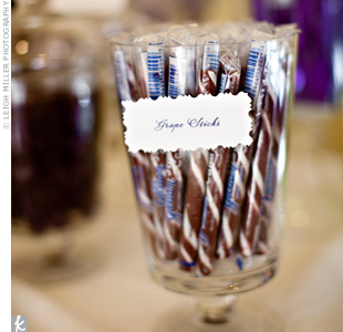"Instead of favors, the couple opted for a candy bar of purple-colored sweets displayed in vintage-style apothecary jars. The couple's planner made a sign that read, ""Un Magasin de BonBon,"" which means candy shop in French."