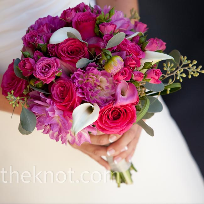 Amy carried a lush pink bouquet of dahlias, roses, and calla lilies with a few white calla lilies in the mix.