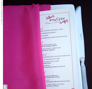 The couple created a signature logo that appeared on much of their wedding stationery, like the pink menu cards.