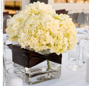 Rather than using many different flowers, Hinako and Reflection opted for centerpieces of all-white hydrangeas in square vases with brown ribbon.