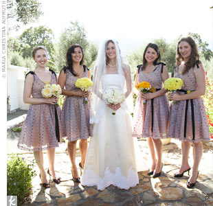 The gray tulle bridesmaid dresses had a little more flare than traditional ones (note the black sashes around the waists and black at the sleeves). Thanks to the yellow lining beneath the tulle, they fit the black, white, and yellow palette perfectly.