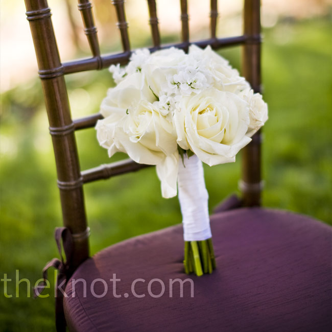 To contrast her bridesmaids' bright-colored dresses and bouquets, Sarah carried an all-white bouquet of garden roses.