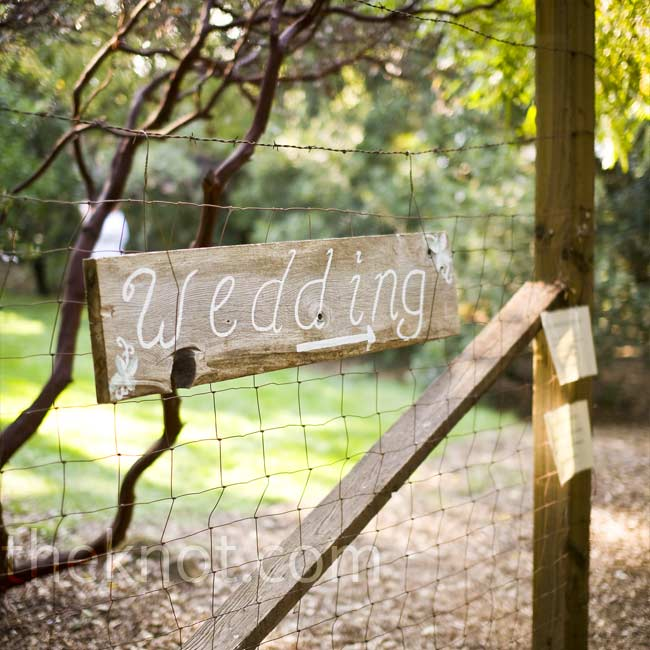 The ceremony and reception took place on the same grounds. A wooden sign pointed guests in the right direction.