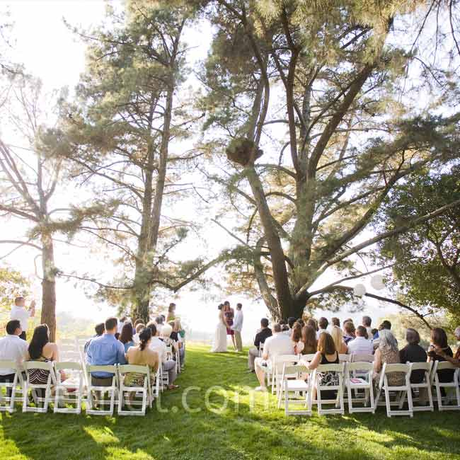 The couple got married beneath a large oak tree on the winery's lawn, facing the lake. Letting the view's beauty shine, they decided not to bring any decorations.