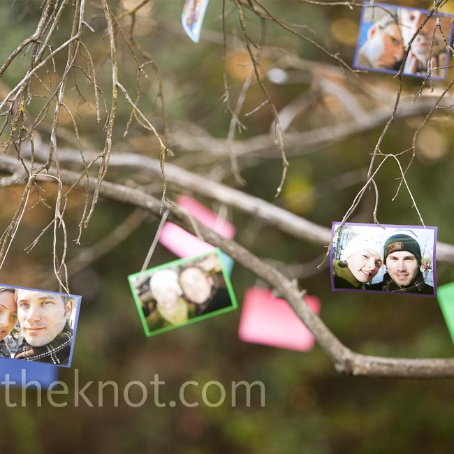 For a personal touch, Sarah and Jason mounted pictures from their dating days on colorful cardstock and hung them from a tree that guests passed on the way into the meadow.