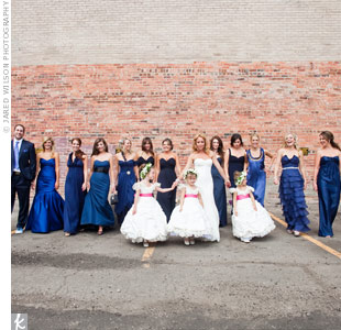 Alissa's 11 bridesmaids chose their own styles of navy dresses, while her one male attendant wore a dark suit. The bride's three nieces all wore poufy white princess dresses and carried miniature bouquets.