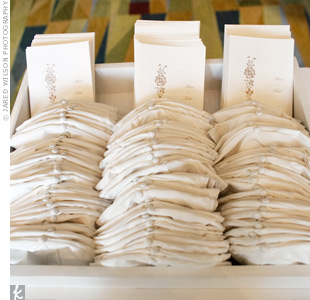 The bride put her DIY skills to use on the simple, white programs printed with natural-colored ink. Friends handed out the programs along with cocktails and champagne as guests entered the room.