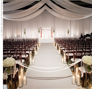 Hurricane lamps in varying heights and white draping made the ceremony space at the Hyatt at Colorado Convention Center modern and intimate. Plus, the convenient hotel rooms were a bonus for out-of-town guests.