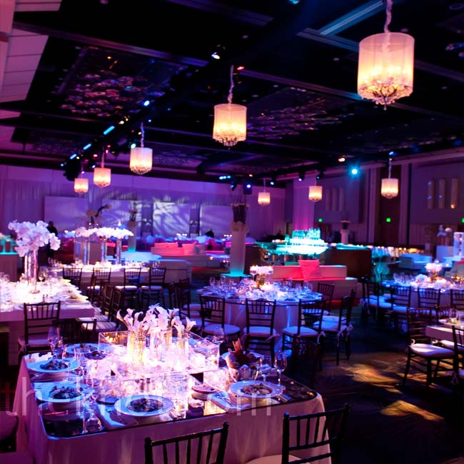 Ambient lighting added a soft wash of lavender to the all-white decor, while multiple table shapes, settings, and centerpieces gave the room variety.