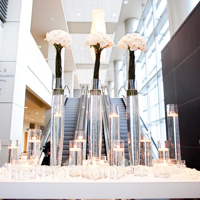 A towering display of roses and floating candles directed guests to the ballroom for cocktail hour.