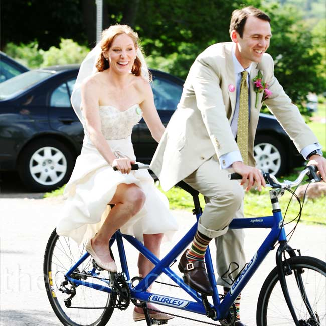 The bride and groom took a spin on a tandem bike, just like the ones throughout their wedding details, after the ceremony.