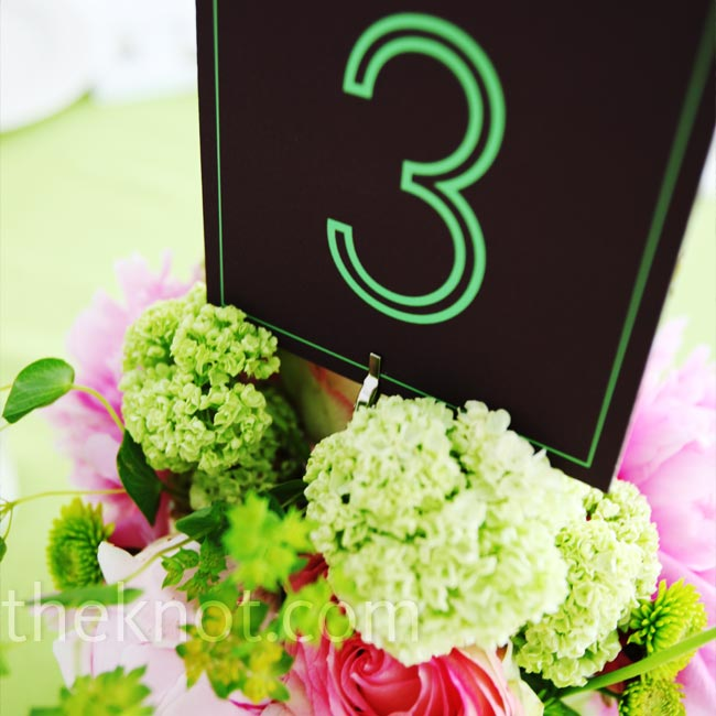 Large green numbers on black cardstock directed guests to their tables.