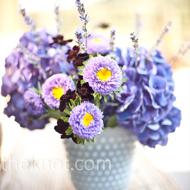 Mismatched vases added casual variety to the decor, while the same milk glass material and purple blooms kept the style cohesive.