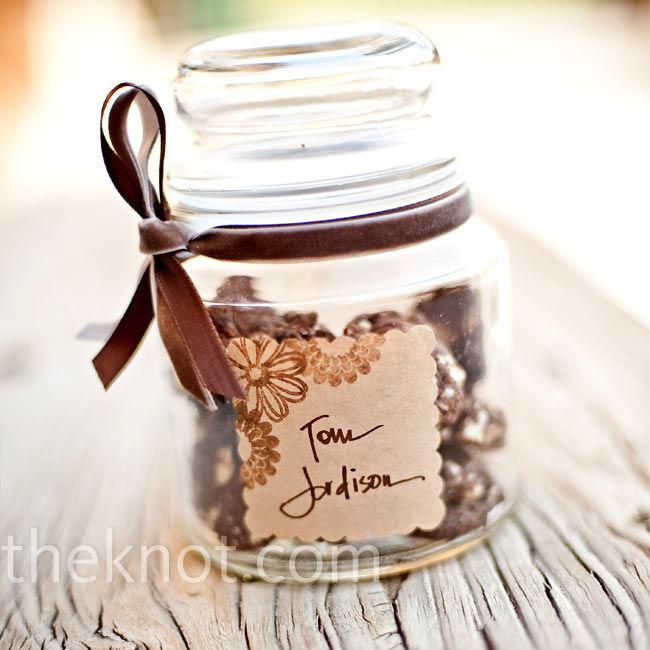 CaraMae gave her guests love straight from her oven. She baked homemade cookies and filled mini-jars with the treats, personalizing the favors with custom labels that also served as place cards.