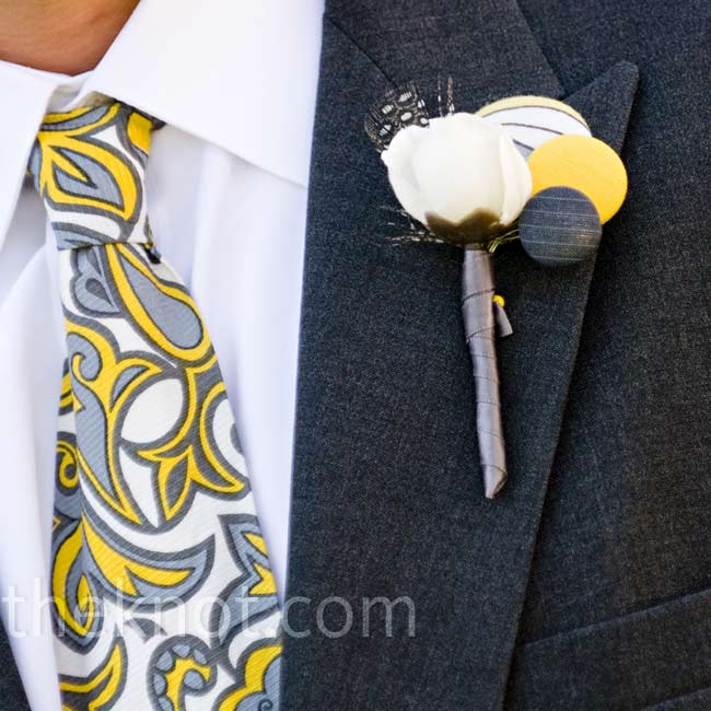 Elizabeth made the men's boutonnieres herself with fabric, leather, and feathers.