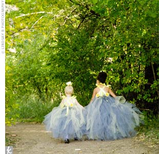 The bride's daughter and god daughter (the flower girl and ring bearer) looked like little fairies as they walked down the aisle in their custom pewter gray and butter yellow dresses. Elizabeth found the designer on Etsy.com.