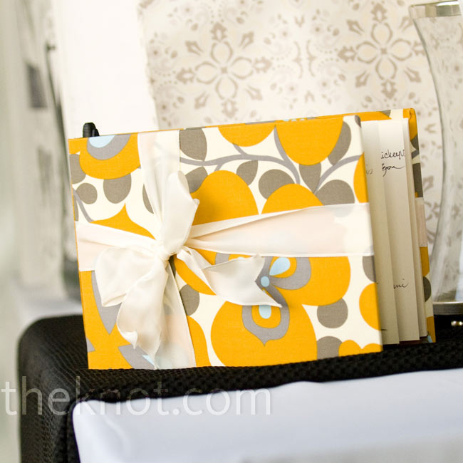 "The bride found the perfect yellow and gray handmade guestbook online. ""It was exactly what I wanted,"" says Elizabeth."