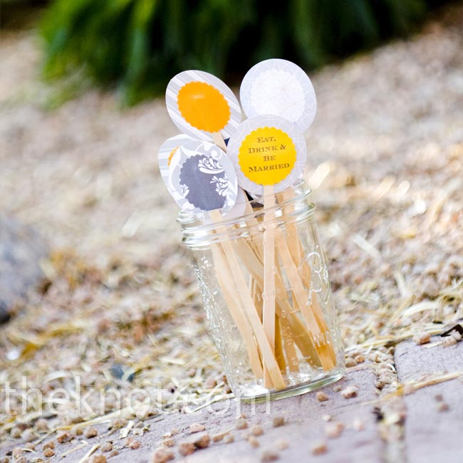 "The bride and her friends made dozens of fun, yellow swizzle sticks with the message, ""Eat, Drink & Be Married."""