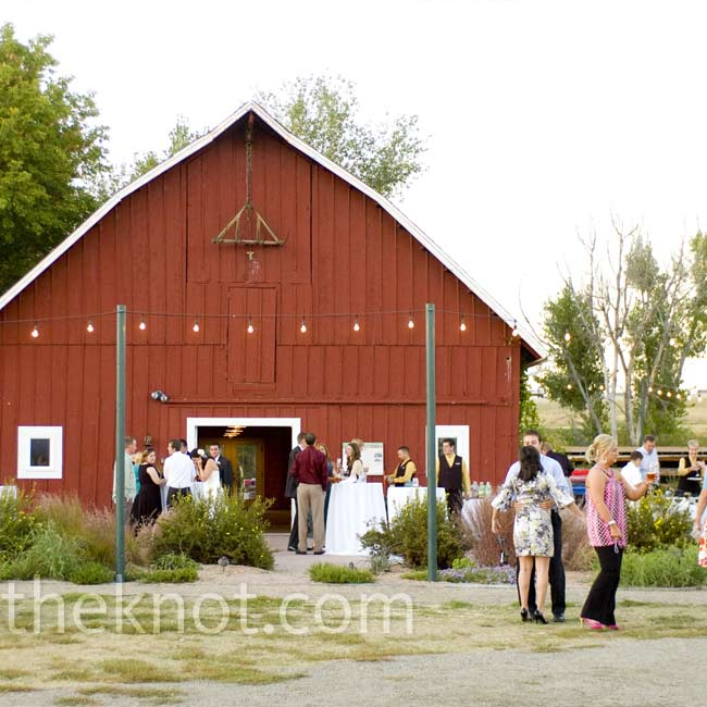 "The red barn at The Botanical Gardens at Chatfield sealed the deal for Elizabeth and Josh. ""I had this vision of a rustic, but classy place for our wedding,"" says the bride."