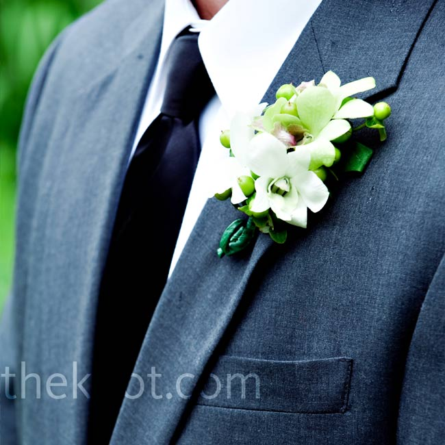 Bryan matched his bride's bouquet with a white orchid and green hypericum berry boutonniere.