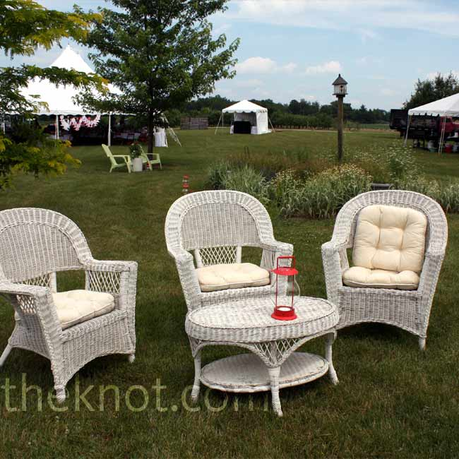 Brooke's parents' yard is tiered, which made every seat a good one for guests at the ceremony. They set up white wooden chairs on their lawn and quilts on their neighbors' hilly lawn so guests who wanted to could sit less formally.