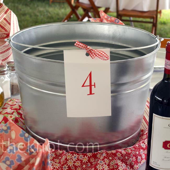 Galvanized buckets (filled with beer and ice) and vintage-style patterned napkins decorated the reception tables.