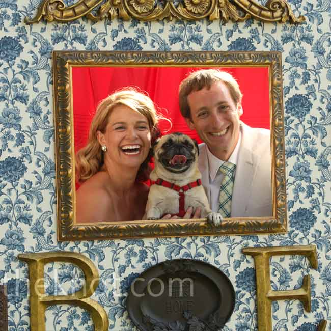 Brooke's aunt and cousin made a board for guests to pop their heads through to take pictures. They cut out holes for vintage-style frames and added plaques and the couple's initials.