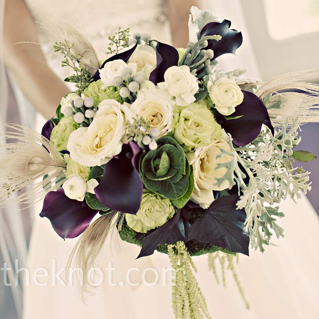 Christine worked bleached peacock feathers into a lush bouquet of black calla lilies, ivory and green roses, ivory ranunculus, begonia leaves, and green hanging amaranthus.