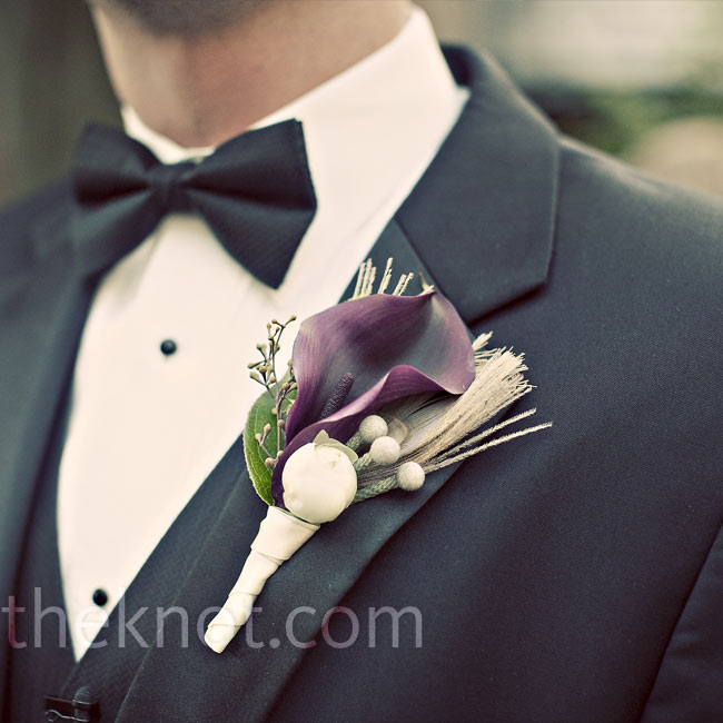 Zac's boutonniere included a black calla lily, an ivory ranunculus bud, silver brunia, and a bleached peacock feather.