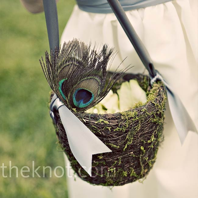 Christine's 3-year-old cousin carried a moss basket with a gray satin ribbon for a handle. The florist accented the basket with peacock feathers and filled it with ivory rose petals.