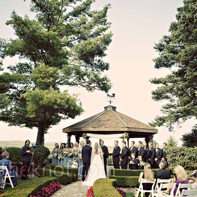 Christine and Zac needed to bring little to decorate their ceremony in the gardens of the Pine Knob Mansion. Simple ivory chiffon panels and arrangements that matched the bridesmaid bouquets decorated the gazebo, and petals covered the aisle.