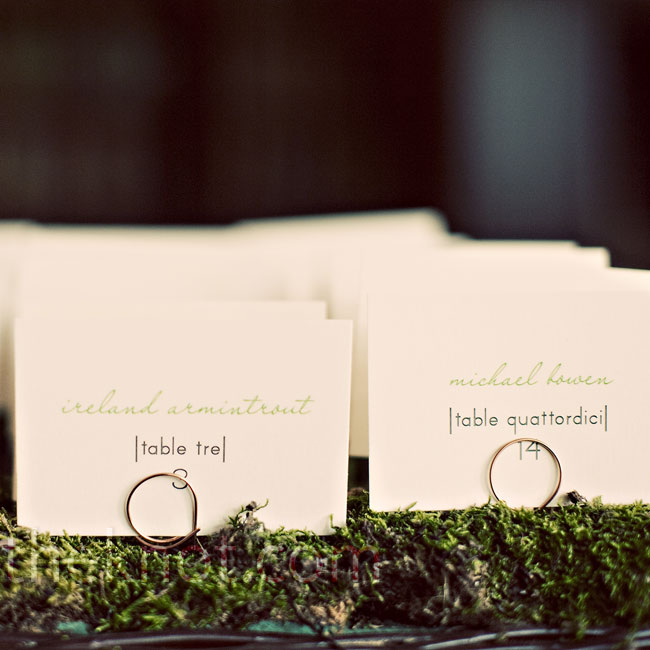 The florist filled two trays with moss as a bed for the escort cards, which were ivory rectangles with the table numbers also written in Italian, a nod to where Christine and Zac were headed for their honeymoon. Tiny wire stands held up the cards.