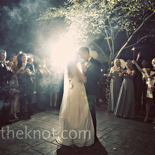 "Guests held sparklers around the patio while Christine and Zac shared their first dance to ""This Year's Love,"" by David Gray, sung and played acoustic guitar style by Jeremy Sprague.  Jeremy and Joshua Sprague were playing the night of the couple's first kiss -- almost eight years to the day of the wedding."