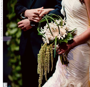 Joanna carried a rustic bouquet of roses and dendrobium orchids in a lily grass caging and hanging amaranthus. Its length worked well with her dramatic dress.